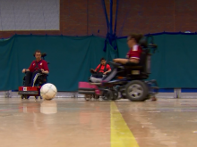 Young people playing powerchair football in the film