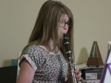 Poppy has not let losing her hearing stop her from playing the clarinet