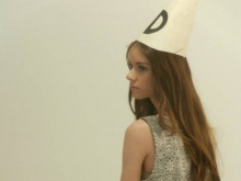 A model poses in a dunce hat for one of the posters