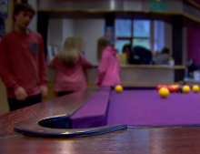 Playing pool at a youth club