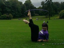 Young person performs with hula-hoop in Belfast
