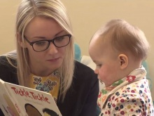 Fixer Amy Collingwood reads to a child