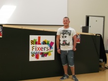 Fixer Curtis standing next to installation