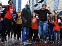 Fixers Stephen jump for joy at event