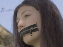 An actress appears with her mouth zipped shut in the film