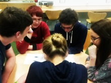 The group of young people discuss their project idea