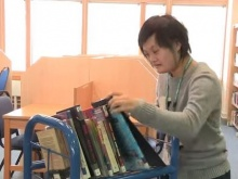 A Fixer uses her skills in a library