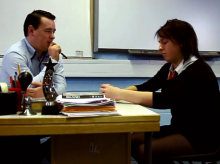 A student talks to a teacher in the film