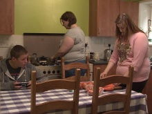 Becky preparing dinner with her siblings at home